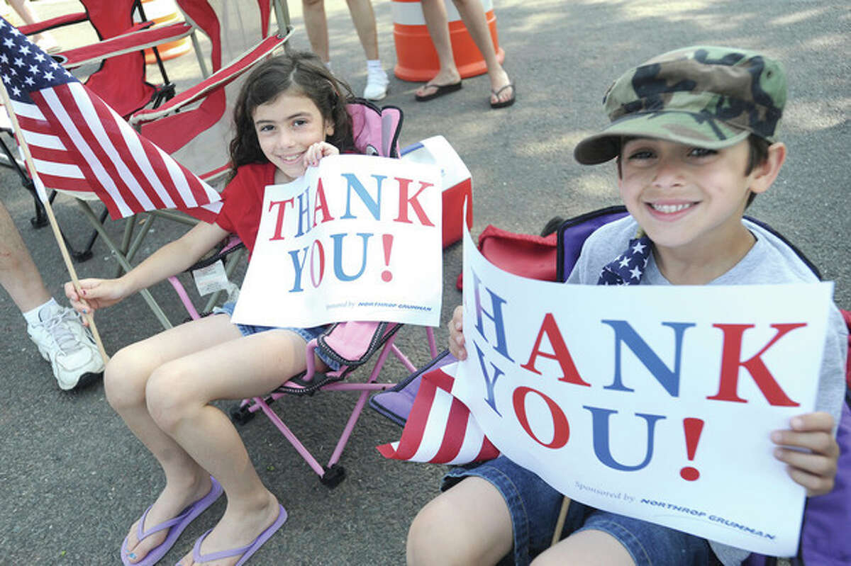 Hour photo/Matthew Vinci Laura Frattaroli 8, and her brother John 7, express their gratitude at the Norwalk Memorial Day Parade Monday.