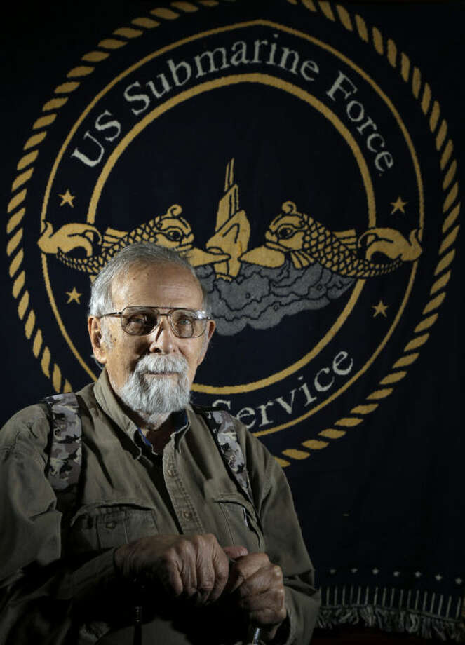 In this May 15, 2014 photo, Paul Wittmer poses for a photo at his home in Manchester, Mo. Wittmer, a submarine veteran from suburban St. Louis who recently turned 90, spent virtually every Tuesday for eight years visiting the National Archives at St. Louis, which houses millions of personnel records from all branches of the military. He compiled biographical information on men lost on submarines during World War II producing a six-volume book. (AP Photo/Jeff Roberson)
