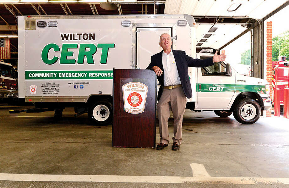 Wilton CERT Executive Director Jack Majesky and other officials dedicate the new CERT emergency response vehicle in a special ceremony at the Wilton Fire Department headquarters Wednesday.