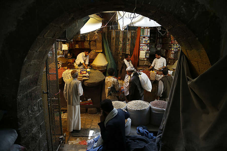 Yemenis shop at a market ahead of the Muslim holy month of Ramadan in the old city of Sanaa, Yemen, Wednesday, June 17, 2015. Muslims throughout the world mark the month of Ramadan, the holiest month in the Islamic calendar, with dawn to dusk fasting. (AP Photo/Hani Mohammed)