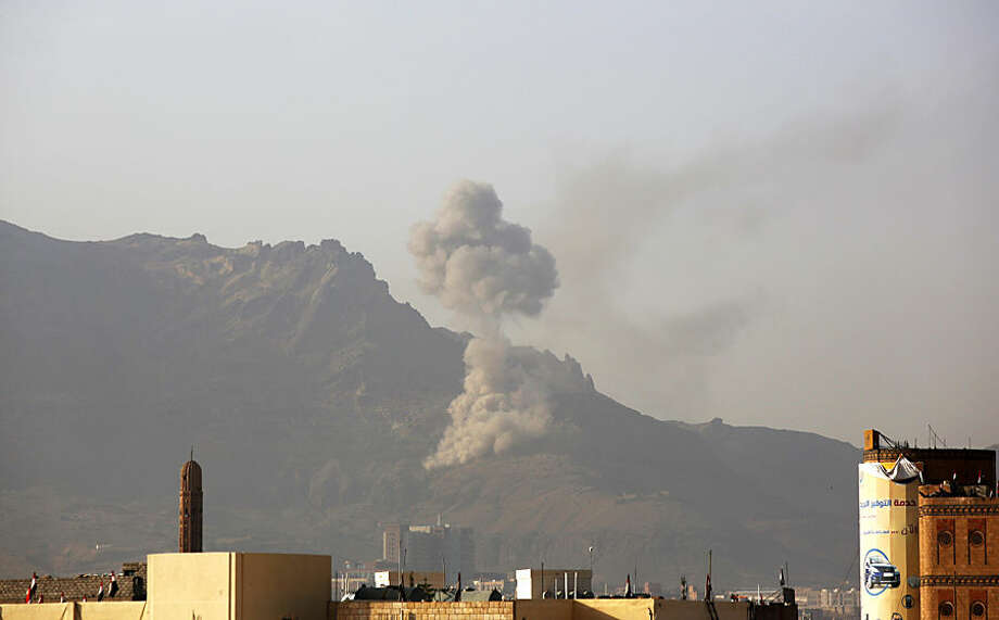 Smoke rises after a Saudi-led airstrike hit a site believed to be one of the largest weapons depot on the outskirts of Yemen's capital, Sanaa, on Wednesday, June 17, 2015. Saudi-led airstrikes hit a convoy of civilians fleeing fighting in southern Yemen early Wednesday, killing tens of people in an attack among the deadliest of the 3-month-old air campaign, medics said. (AP Photo/Hani Mohammed)