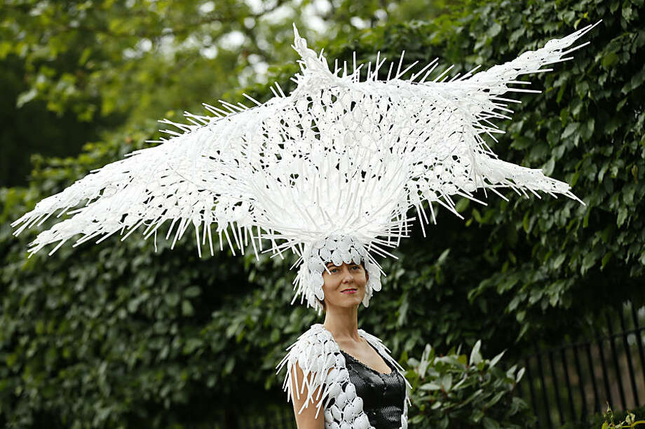 Larissa Katz poses for photographers on the second day of Royal Ascot horse racing meet at Ascot, England, Wednesday, June 17, 2015. Royal Ascot is the annual five day horse race meeting that Britain's Queen Elizabeth II attends every day of the event.(AP Photo/Alastair Grant)