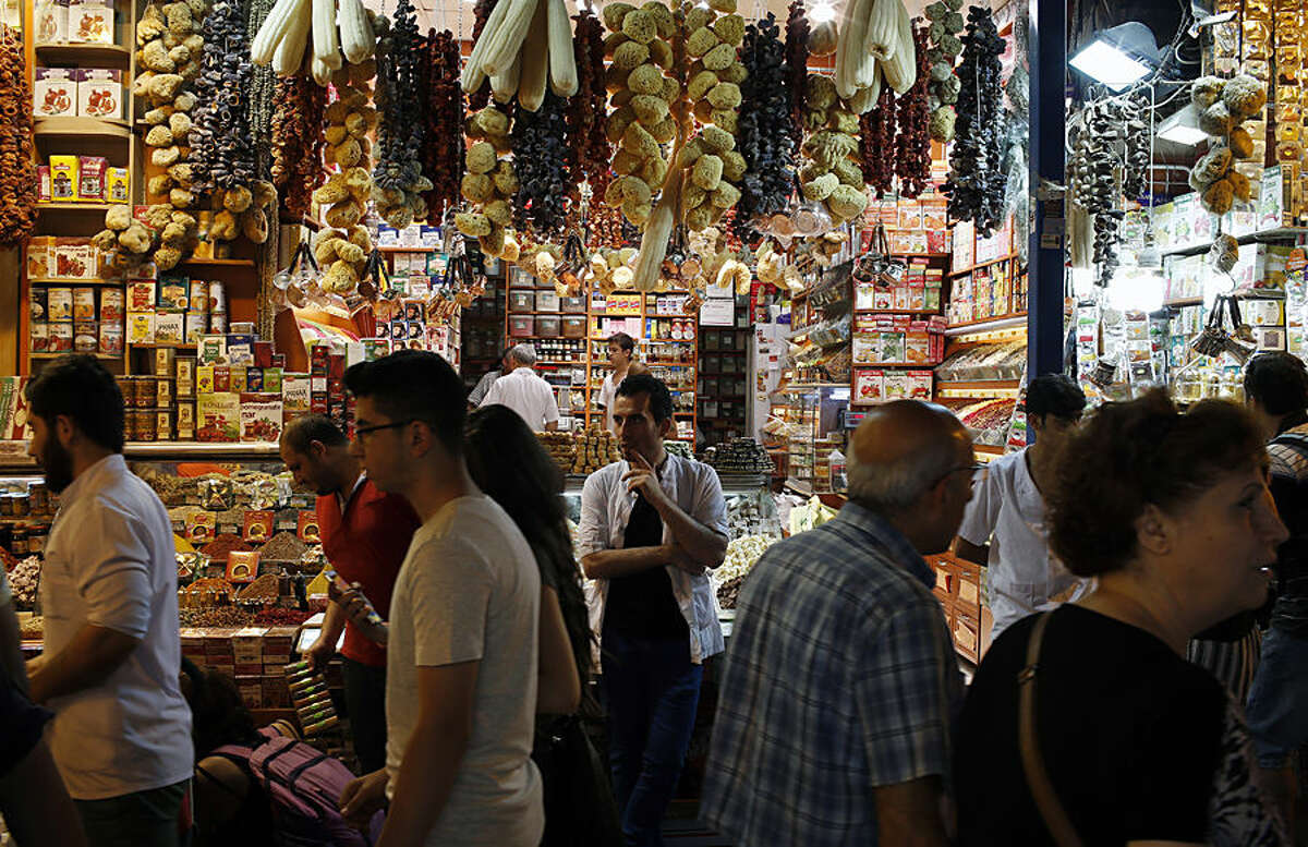 People walk around the iconic Spice Bazaar, in the historic Sultanahmet district of Istanbul, Turkey, Wednesday, June 17, 2015. Millions of Muslims around the world will mark the start of Ramadan on Thursday June 18, a month of intense prayer, dawn-to-dusk fasting and nightly feasts. Muslims follow a lunar calendar and a moon-sighting methodology that can lead to different countries declaring the start of Ramadan a day or two apart. (AP Photo/Emrah Gurel)