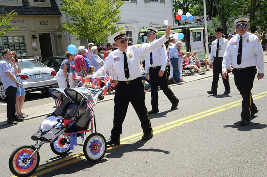 Members of the Roawayton Fire Department at the Rowayton Memorial Day Parade on Sunday. Hour photo/Matthew Vinci