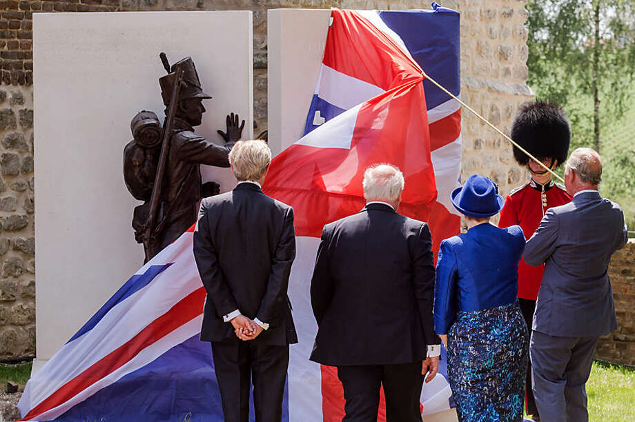 Charles, Prince of Wales, right, unveils a monument to the Battle of Waterloo during the ceremonial opening of the Hougoumont Farm in Braine-l'Alleud, near Waterloo, Belgium on Wednesday, June 17, 2015. Hougoumont Farm played a critical role in the outcome of the Battle of Waterloo, and the newly restored farm will open to the general public on June 18, 2015. (AP Photo/Geert Vanden Wijngaert, Pool)