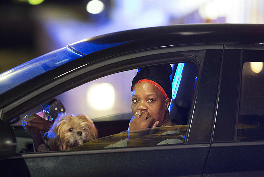 A passing motorist looks out her window as she stops at an intersection down the street from the Emanuel AME Church early Thursday, June 18, 2015 following a shooting Wednesday night in Charleston, S.C. (AP Photo/David Goldman)