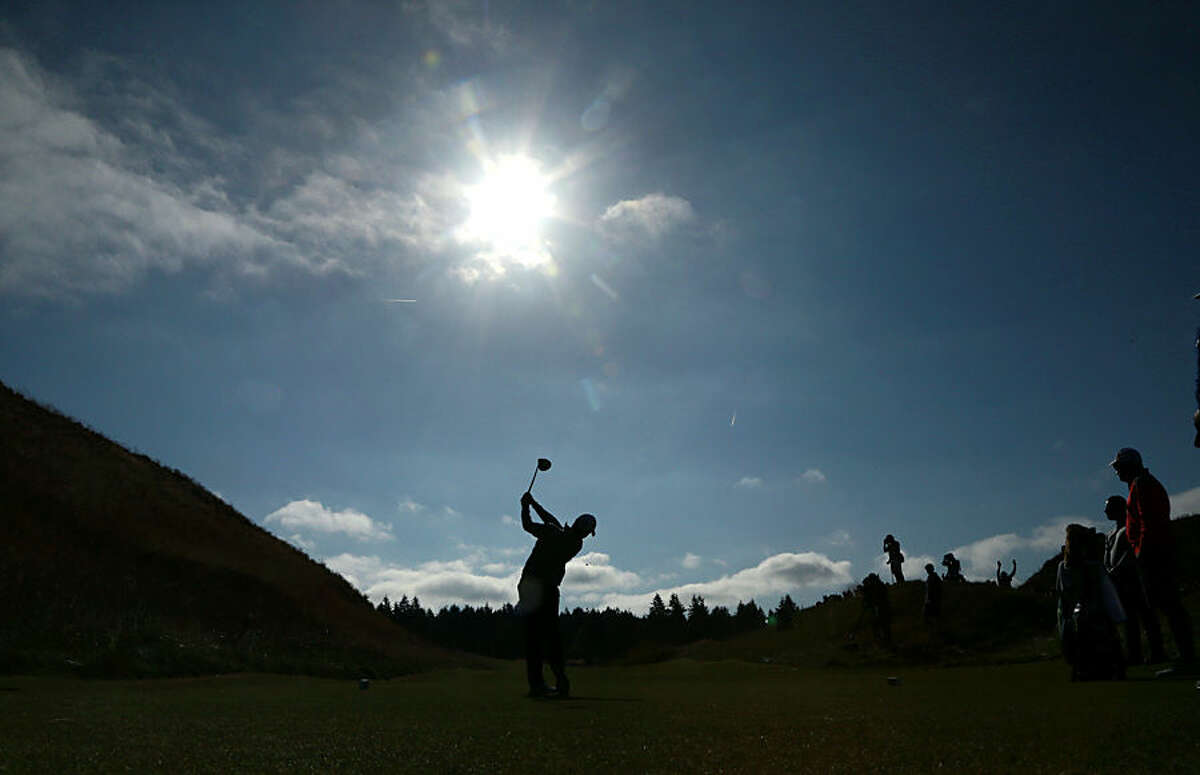 Rory McIlroy, of Northern Ireland, watches his tee shot on the 13th hole during a practice round for the U.S. Open golf tournament at Chambers Bay on Wednesday, June 17, 2015 in University Place, Wash. (AP Photo/Charlie Riedel)