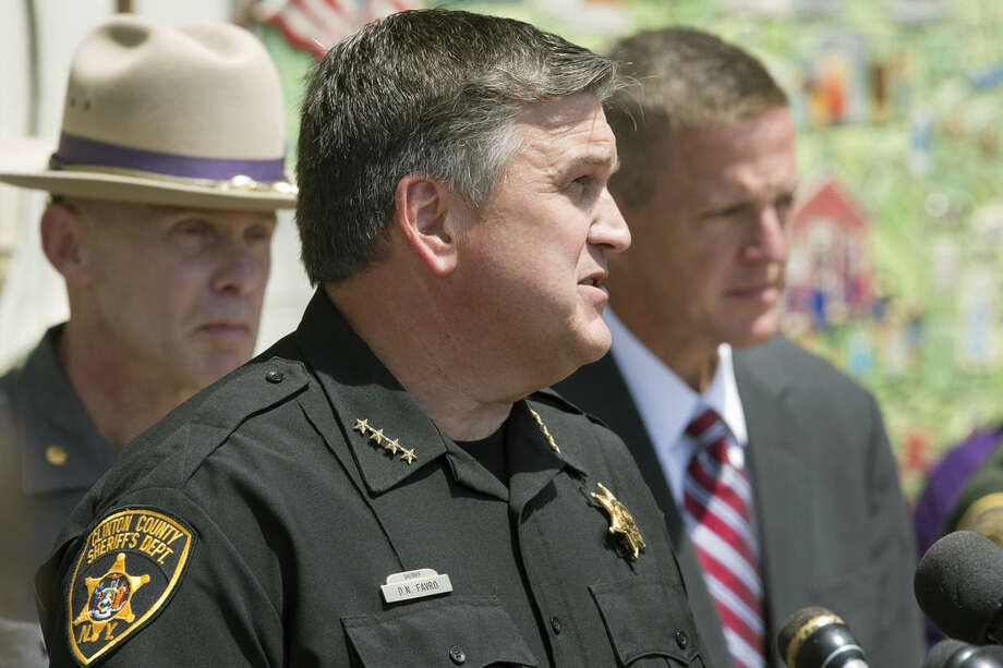 Maj. Charles Guess, left, with the New York State Police, Clinton County Sheriff David Favro, center, and Clinton County District Attorney Andrew Wylie attend a news conference, Wednesday, June 17, 2015, in Plattsburgh, N.Y. where they discussed the escape of David Sweat and Richard Matt from the Clinton Correctional Facility in Dannemora, N.Y. The pair escaped from the maximum-security facility 12 days ago. (AP Photo/Mark Lennihan)