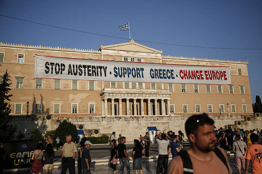 Protesters take part in an anti-austerity rally in front of the parliament in Athens, Greece, on Wednesday, June 17, 2015. Greece and its creditors publicly blamed one another for an impasse in bailout talks, on the eve of a eurozone finance ministers' meeting billed as key to their outcome. (AP Photo/Yorgos Karahalis)