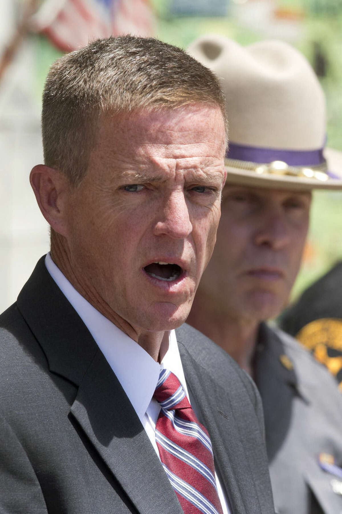 Clinton County District Attorney Andrew Wylie, left, and Maj. Charles Guess, right, with the New York State Police attend a news conference, Wednesday, June 17, 2015 in Plattsburgh, N.Y. where they discussed the escape of David Sweat and Richard Matt from the Clinton Correctional Facility in Dannemora, N.Y. The pair escaped from the maximum-security facility 12 days ago. (AP Photo/Mark Lennihan)