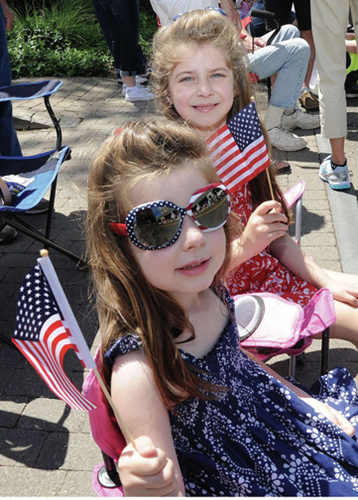 Audra 4 and her sister Alexa 6 Sunday at the Rowayton Memorial Day Parade. Hour photo/Matthew Vinci
