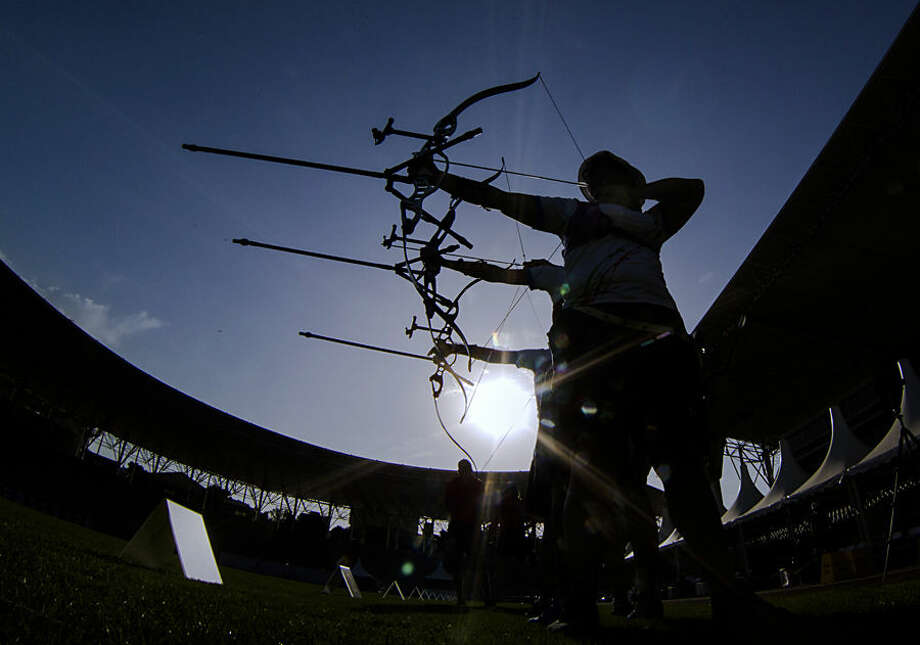 Athletes of the Italian archery team attend a training session prior to the women's quarter final competition at the 2015 European Games in Baku, Azerbaijan, Thursday, June 18, 2015. (AP Photo/Dmitry Lovetsky)