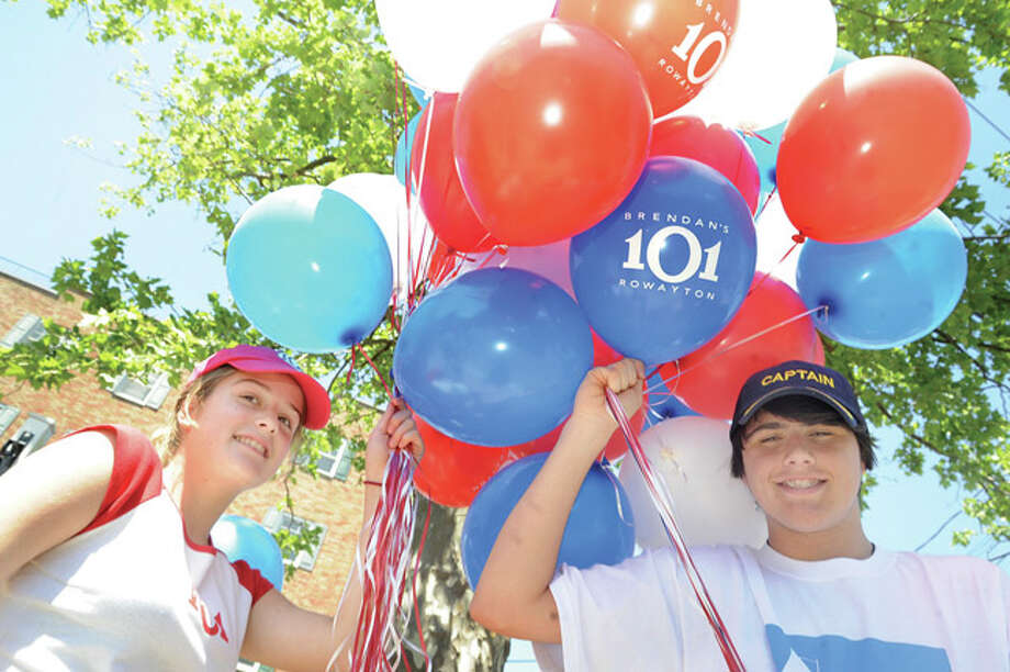 Amand Blaze 14 and Garvin McGee 13 hand out balloons Sunday at the Rowayton Memorial Day Parade. Hour photo/Matthew Vinci
