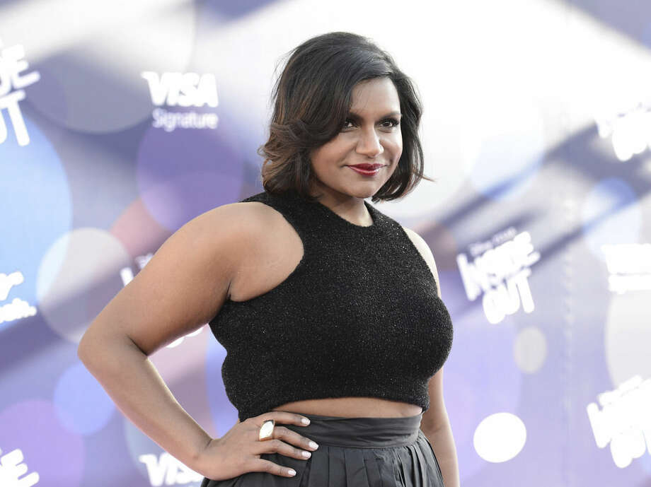 "FILE - In this Monday, June 8, 2015 file photo, Mindy Kaling attends the Los Angeles premiere of ""Inside Out"" at the El Capitan Theatre in Los Angeles. Kaling agreed to voice a character in Pixar's latest film based on nothing more than an illustration. ""They literally could have shown me nothing,"" said Kaling, who plays a green, fluttery-lashed girl named Disgust in the new film ""Inside Out."" She heard the word ""Pixar,"" and she was in. (Photo by Dan Steinberg/Invision/AP, File)"