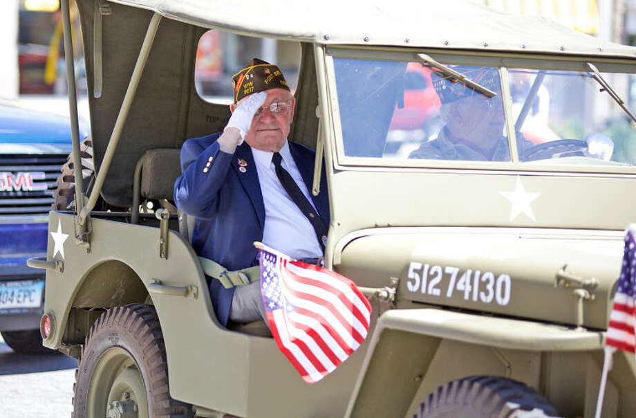 National Guard Veteran Frank Demasi salutes the crowd during Stamford's annual Memorial Day Parade Saturday afternoon. Hour Photo / Danielle Calloway