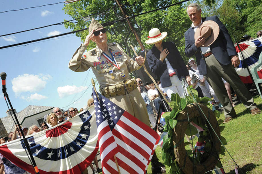 World War II veteran Douglas Bora lays a wreath Sunday at the Rowayton Memorial Day Parade. Hour photo/Matthew Vinci