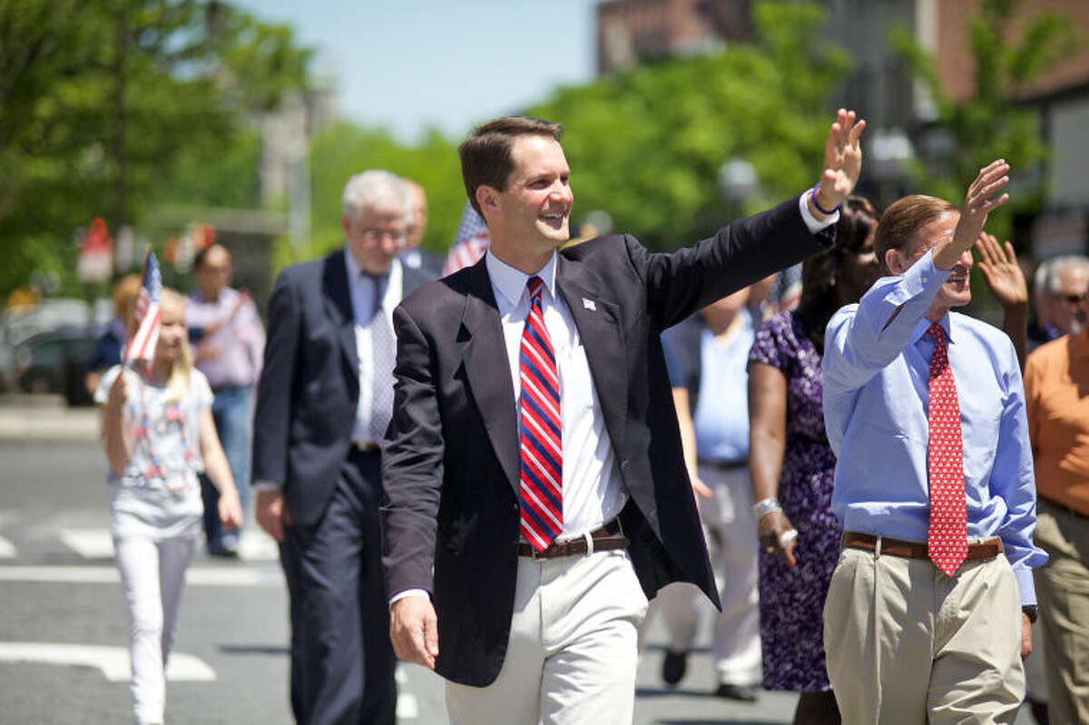 Congressman Jim Himes waves to the crows during Stamford's annual Memorial Day Parade Saturday afternoon. Hour Photo / Danielle Calloway