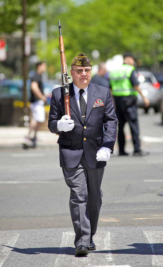 Veteran Bob Cooley marches in Stamford's annual Memorial Day Parade Saturday afternoon. Hour Photo / Danielle Calloway