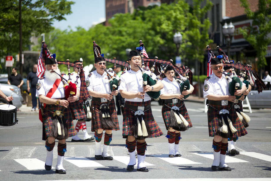 Bag pipers play in Stamford's annual Memorial Day Parade Saturday afternoon. Hour Photo / Danielle Calloway