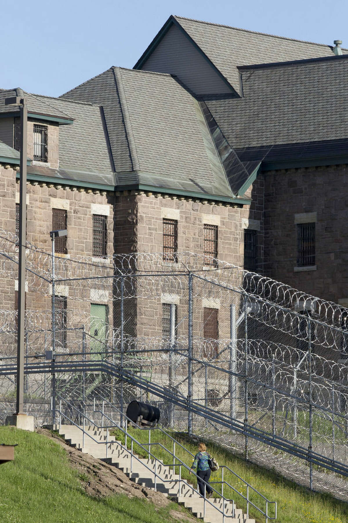 An employee arrives at the Clinton Correctional Facility, Wednesday, June 17, 2015 in Dannemora, N.Y. Search teams are back in the woods of northern New York looking for two convicted murderers who broke out of the maximum-security prison a week and a half ago. More than 800 law enforcement officers are in the 12th day of searching for David Sweat and Richard Matt. (AP Photo/Mark Lennihan)