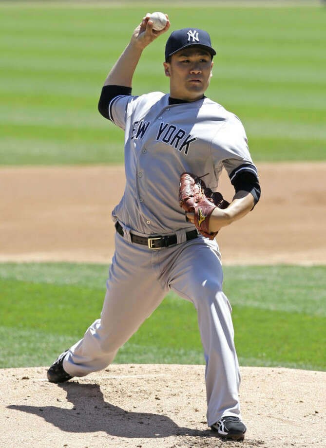 New York Yankees starter Masahiro Tanaka, of Japan, throws against the Chicago White Sox during the first inning of a baseball game in Chicago on Sunday, May 25, 2014. (AP Photo/Nam Y. Huh)