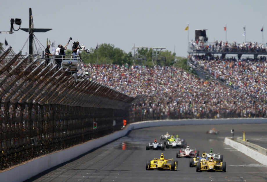 Ryan Hunter-Reay celebrates as he takes the checkered flag to win the 98th running of the Indianapolis 500 IndyCar auto race at the Indianapolis Motor Speedway in Indianapolis, Sunday, May 25, 2014. (AP Photo/Darron Cummings)