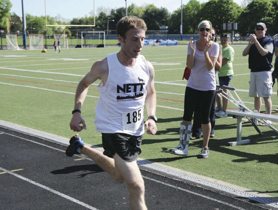 Zack Schwartz with a time of 15:07 at the Learn to Read 5K race at Wilton High School on Sunday. Hour photo/Matthew Vinci