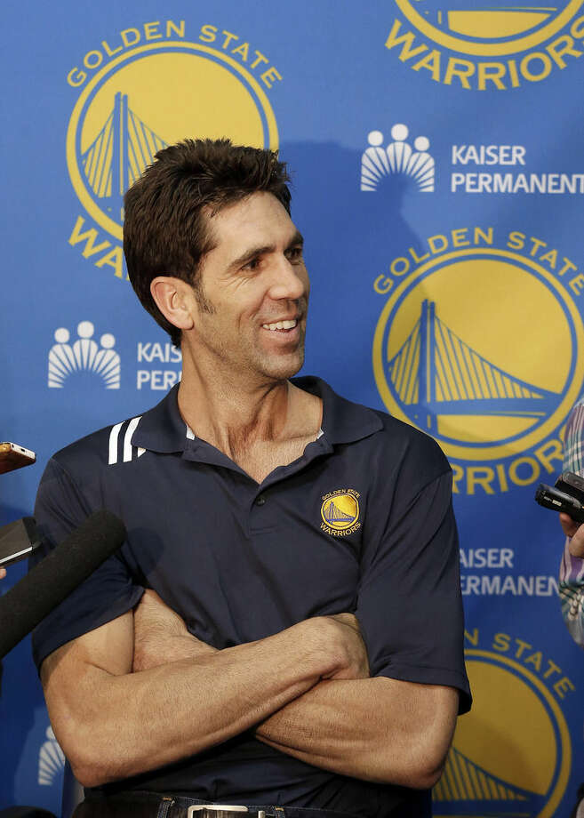 Golden State Warriors general manager Bob Myers smiles while speaking to reporters at the team's practice facility in Oakland, Calif., Thursday, June 18, 2015. The Warriors believe their first title in 40 years could be the first of many more. With their young core signed long-term and MVP Stephen Curry just entering his prime, the Warriors are certainly set up to make several championship runs. (AP Photo/Jeff Chiu)