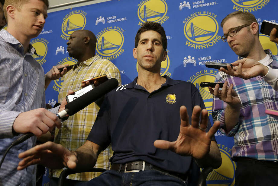 Golden State Warriors general manager Bob Myers speaks to reporters at the team's practice facility in Oakland, Calif., Thursday, June 18, 2015. The Warriors believe their first title in 40 years could be the first of many more. With their young core signed long-term and MVP Stephen Curry just entering his prime, the Warriors are certainly set up to make several championship runs. (AP Photo/Jeff Chiu)