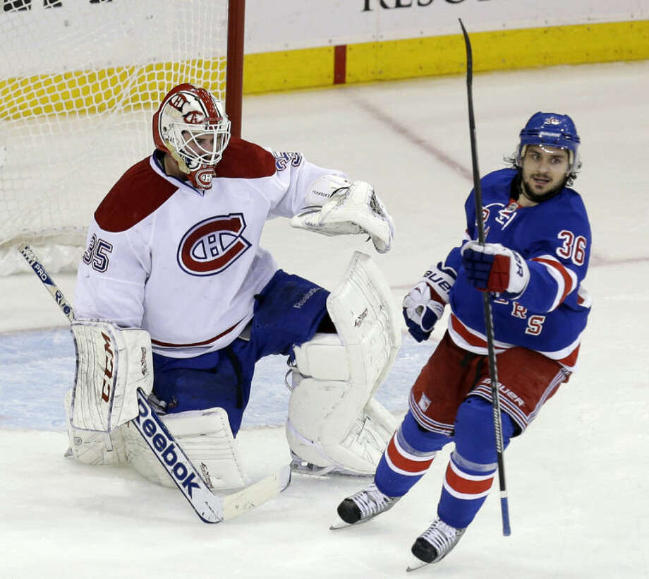 Montreal Canadiens goalie Dustin Tokarski, left, and New York Rangers' Mats Zuccarello react after New York Rangers' Derick Brassard scored during the second period of Game 4 of the NHL hockey Stanley Cup playoffs Eastern Conference finals, Sunday, May 25, 2014, in New York. (AP Photo/Seth Wenig)