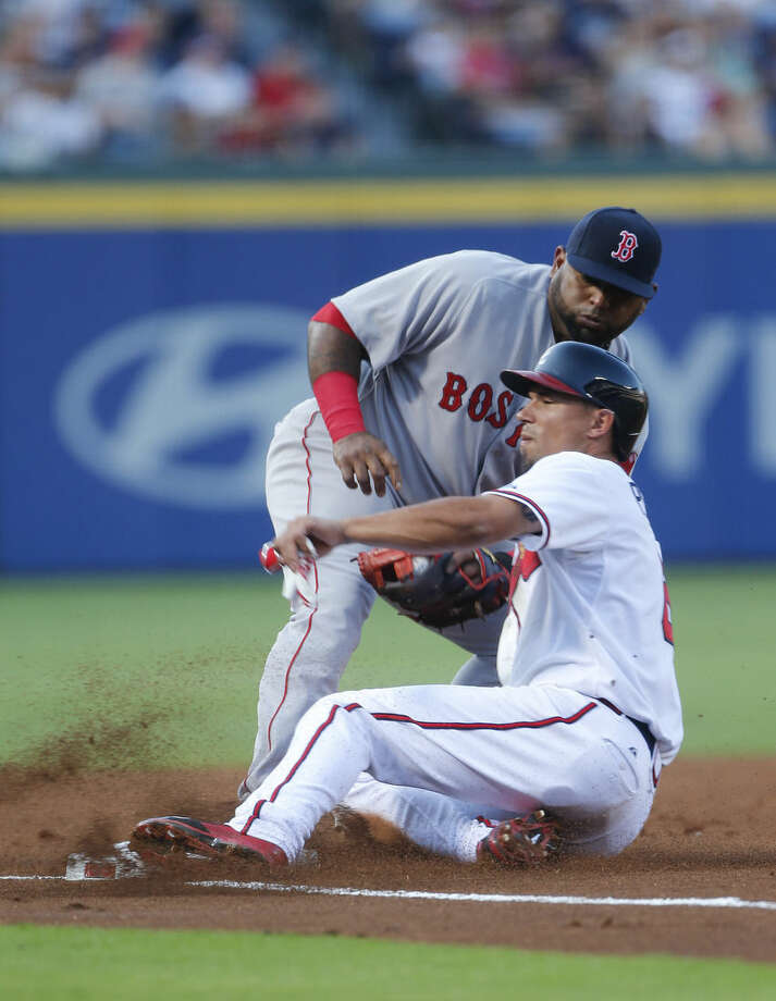 Atlanta Braves' Jace Peterson (8) is tagged out at third by Boston Red Sox third baseman Pablo Sandoval (48) on a Cameron Maybin ground ball in the first inning of a baseball game Wednesday, June 17, 2015, in Atlanta. (AP Photo/John Bazemore)