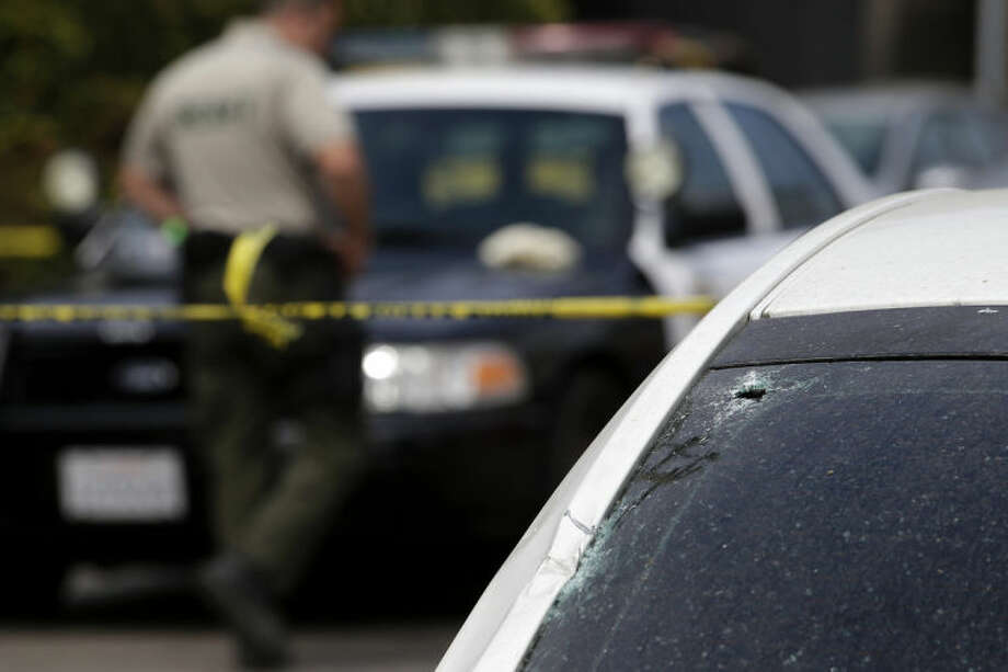 This photo shows the windshield of a car that was shattered by a bullet at the scene of a shooting on Saturday, May 24, 2014, in Isla Vista, Calif. A drive-by shooter went on a rampage near a Santa Barbara university campus that left seven people dead, including the attacker, and others wounded, authorities said Saturday. (AP Photo/Jae C. Hong)