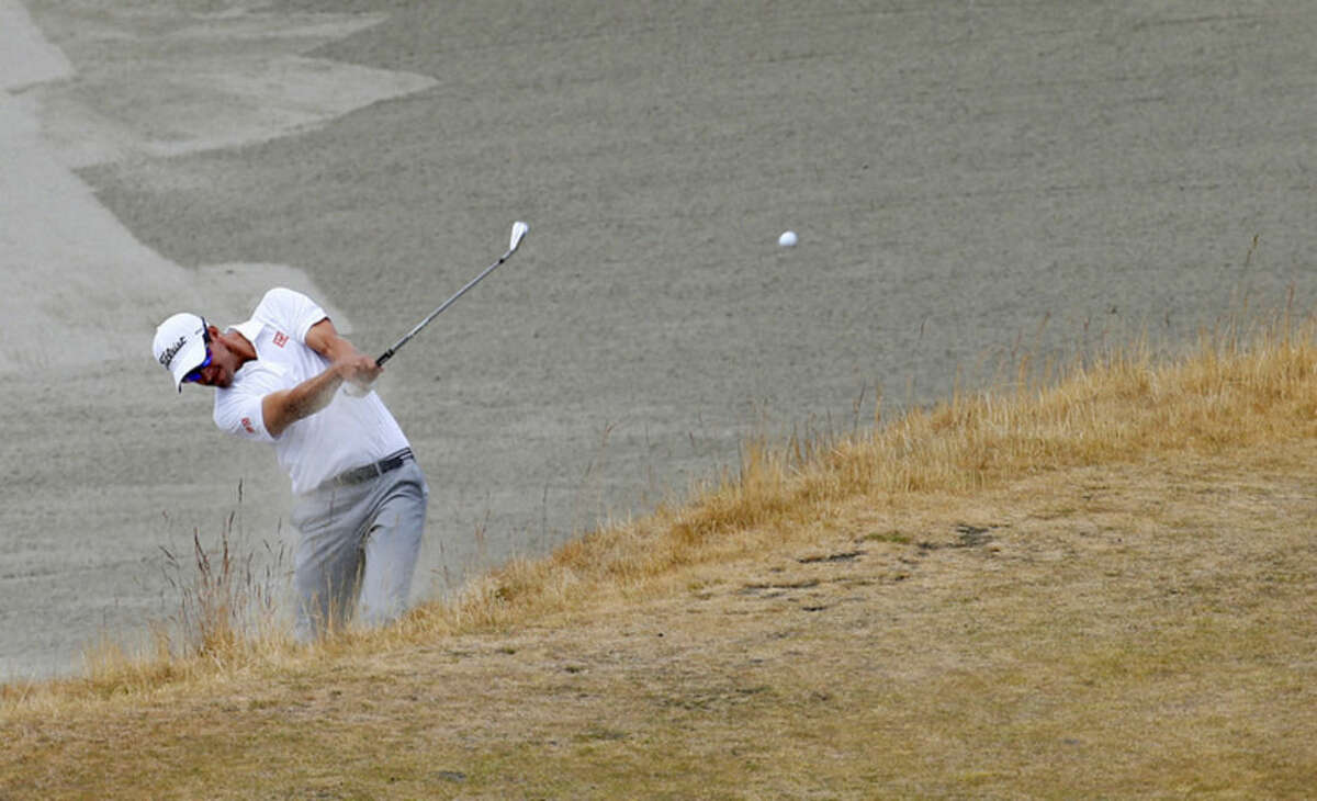 Adam Scott, of Australia, hits out of the bunker on the seventh hole during the first round of the U.S. Open golf tournament at Chambers Bay on Thursday, June 18, 2015 in University Place, Wash. (AP Photo/Matt York)