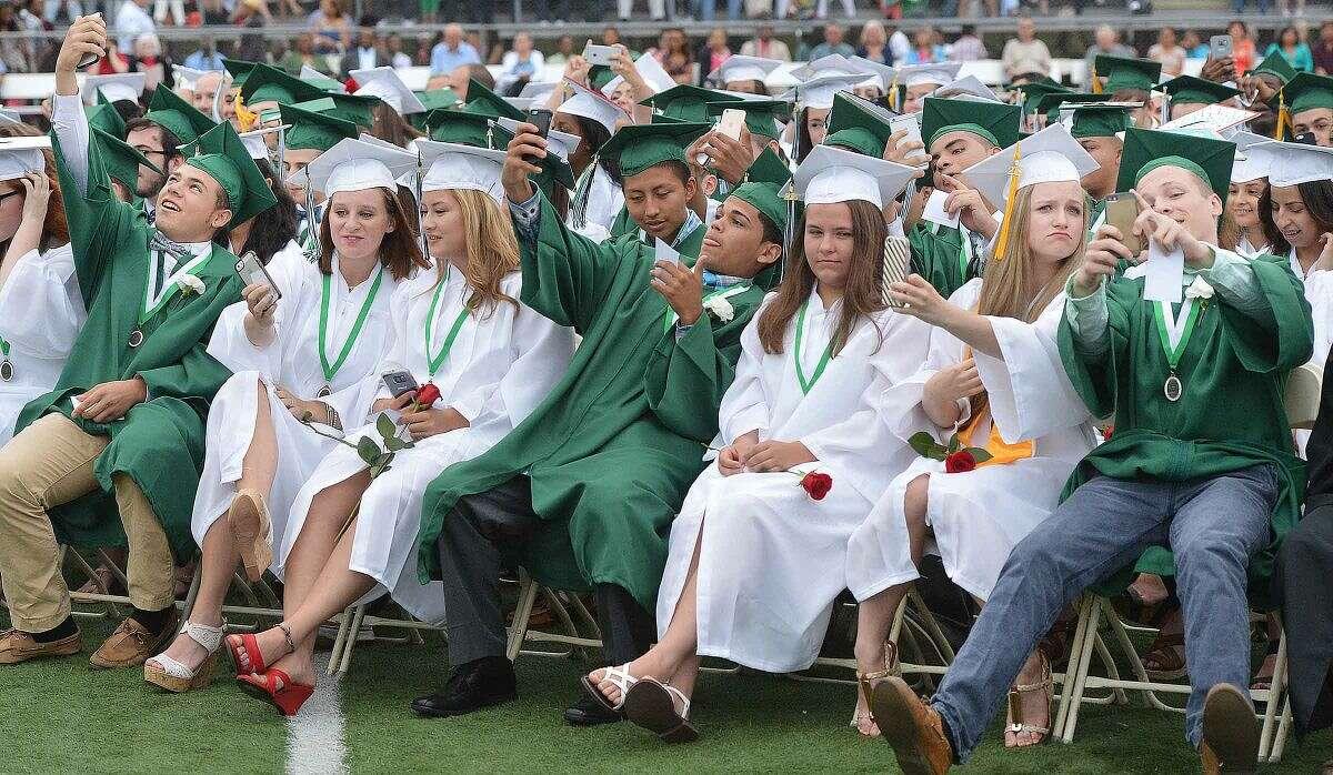 Hour Photo/Alex von Kleydorff Valedictorian Kasey Hogan during her remarks asks the class of 2015 to all take a selfie during Norwalk High School graduation