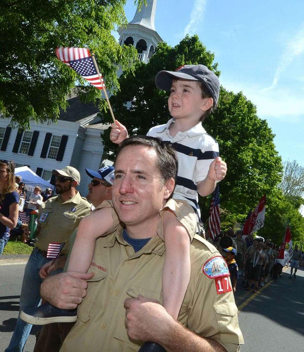 Hour Photo/Alex von Kleydorff Pack 17 Cub Scout 4yr old Gavin Rafferty gets a ride on dad Brian's shoulders the last few feet during Wilton Memorial Day Parade
