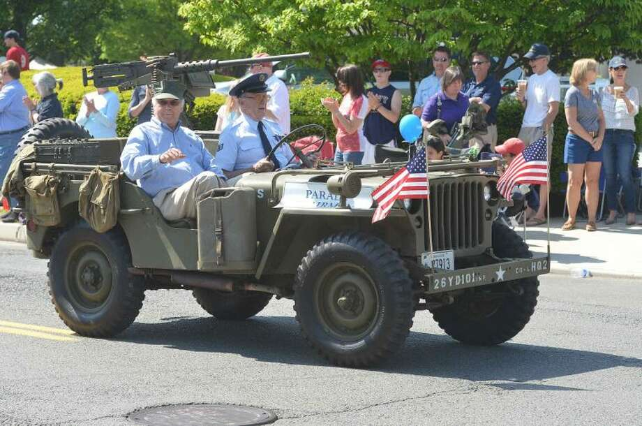 Hour Photo/Alex von Kleydorff Wilton's Memorial Day Parade makes its way through the town center on Monday