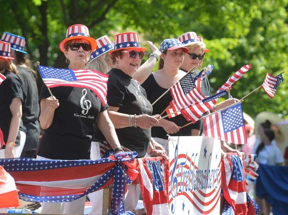 Hour Photo/Alex von Kleydorff Wilton's Memorial Day Parade makes its way through the town center and up to the Congregational Church