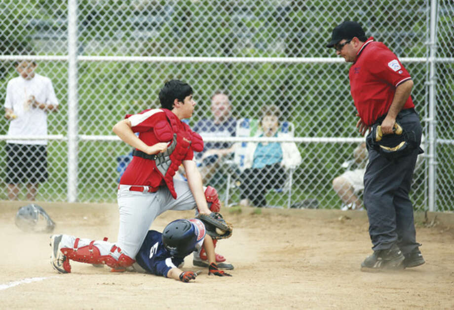 Hour photo/Danielle CallowayBonaddio Construction's Jake Pomponi, looks for the call during the Norwalk Little League winner take-all game against Monker Grotto at Broad River Field Thursday evening.