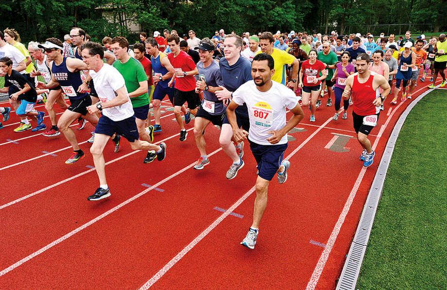 Hour photo / Erik Trautmann Around 200 participants start out on the summer's first Lightfoot running series race, a 3-miler, at Norwalk High School Saturday.