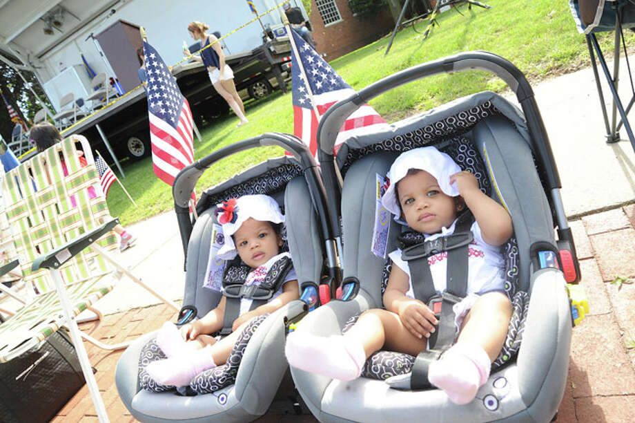 Chanel and Tiffany Thompson 11 month old twins at the Memorial Day Parade Monday in Norwalk. Hour photo Matthew Vinci