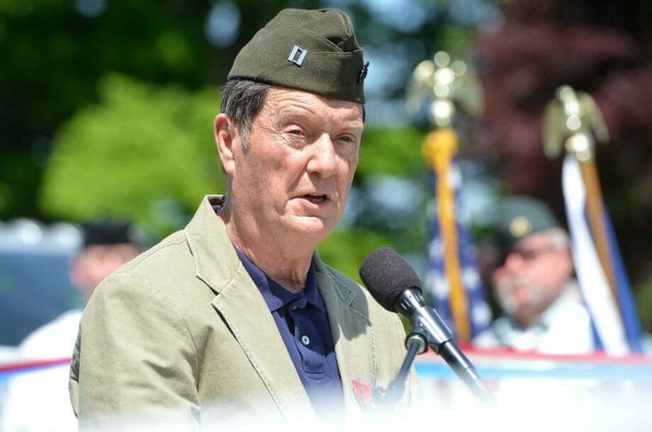Hour Photo/Alex von Kleydorff U.S.M.C Captain (Ret) Jim Newton speaks during his keynote address at Hillside Cemetery during Wilton's Memorial Day