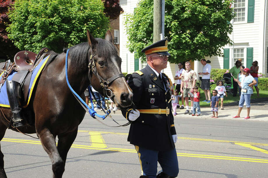 A riderless horse representing vetrans lost at the Memorial Day Parade Monday in Norwalk. Hour photo Matthew Vinci