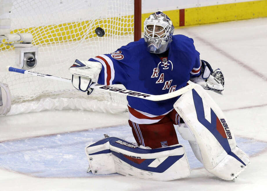 New York Rangers goalie Henrik Lundqvist makes a save during the first period of Game 4 of the NHL hockey Stanley Cup playoffs Eastern Conference finals against the Montreal Canadiens, Sunday, May 25, 2014, in New York. (AP Photo/Seth Wenig)