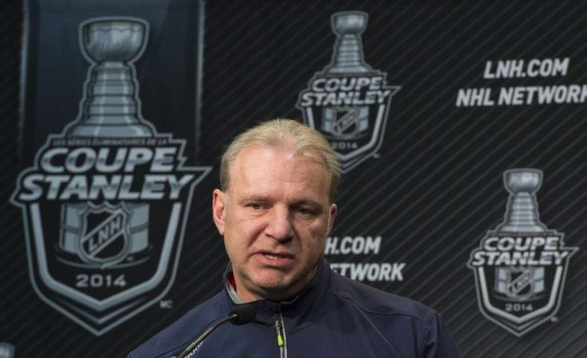 Montreal Canadiens head coach Michel Therrien responds to a question during a news conference Monday, May 26, 2014 in Brossard, Quebec. The Canadiens will face the New York Rangers Tuesday in Game 5 of the NHL hockey Eastern Conference Finals. The Rangers lead the best-of-seven series 3-1. (AP Photo/The Canadian Press, Paul Chiasson)