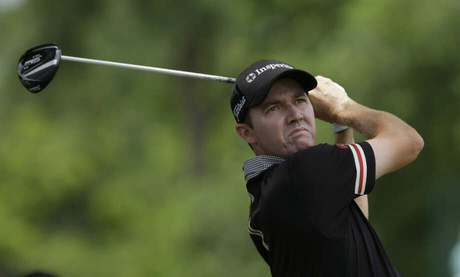 Jimmy Walker watches his tee shot on the third hole during the final round of the PGA Colonial golf tournament in Fort Worth, Texas, Sunday, May 25, 2014. (AP Photo/LM Otero)