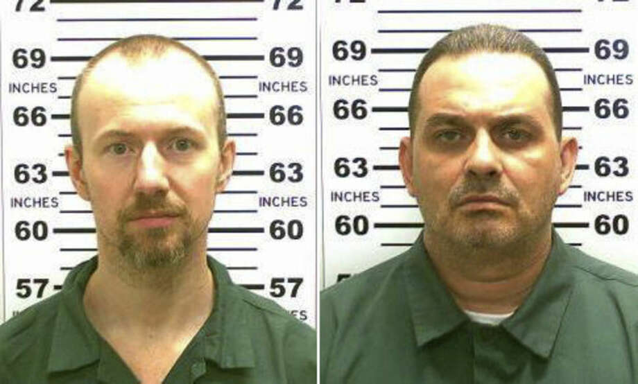 FILE - This combination of file photos released by the New York State Police shows David Sweat, left, and Richard Matt. Matt, who staged a brazen escape from an upstate maximum-security prison with Sweat and had been hunted for three weeks was shot and killed Friday, June 26, 2015. Sweat was shot and captured on Sunday, June 28. (New York State Police via AP, File)