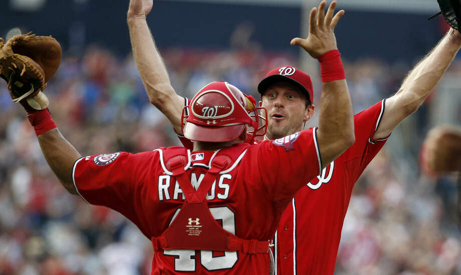 Washington Nationals starting pitcher Max Scherzer, right, celebrates with catcher Wilson Ramos (40) after his no hitter baseball game against the Pittsburgh Pirates, Saturday, June 20, 2015, in Washington. The Nationals won 6-0. (AP Photo/Alex Brandon)