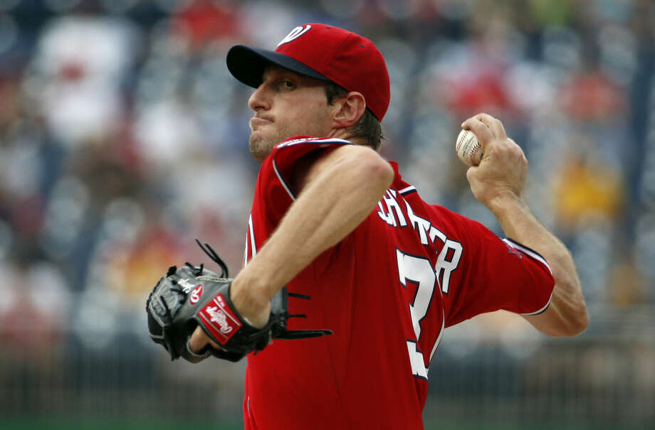 Washington Nationals starting pitcher Max Scherzer throws during the first inning of a baseball game against the Pittsburgh Pirates, Saturday, June 20, 2015, in Washington. (AP Photo/Alex Brandon)