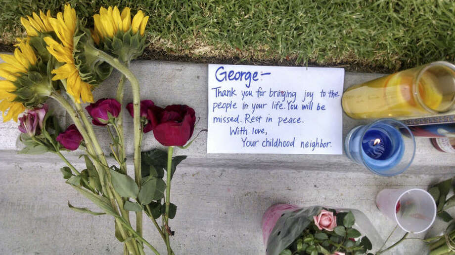 A note addressed to George Chen, 20, of San Jose, Calif., one of three men found stabbed to death in the apartment of Elliott Rodger, is seen outside the apartment where he lived in the Isla Vista neighborhood of Goleta, Calif., Monday, May 26, 2014. Six people, all students at nearby University of California, Santa Barbara, were killed before Rodger was killed by gunfire in the 10-minute rampage Friday, May 23. (AP Photo/Christopher Weber)