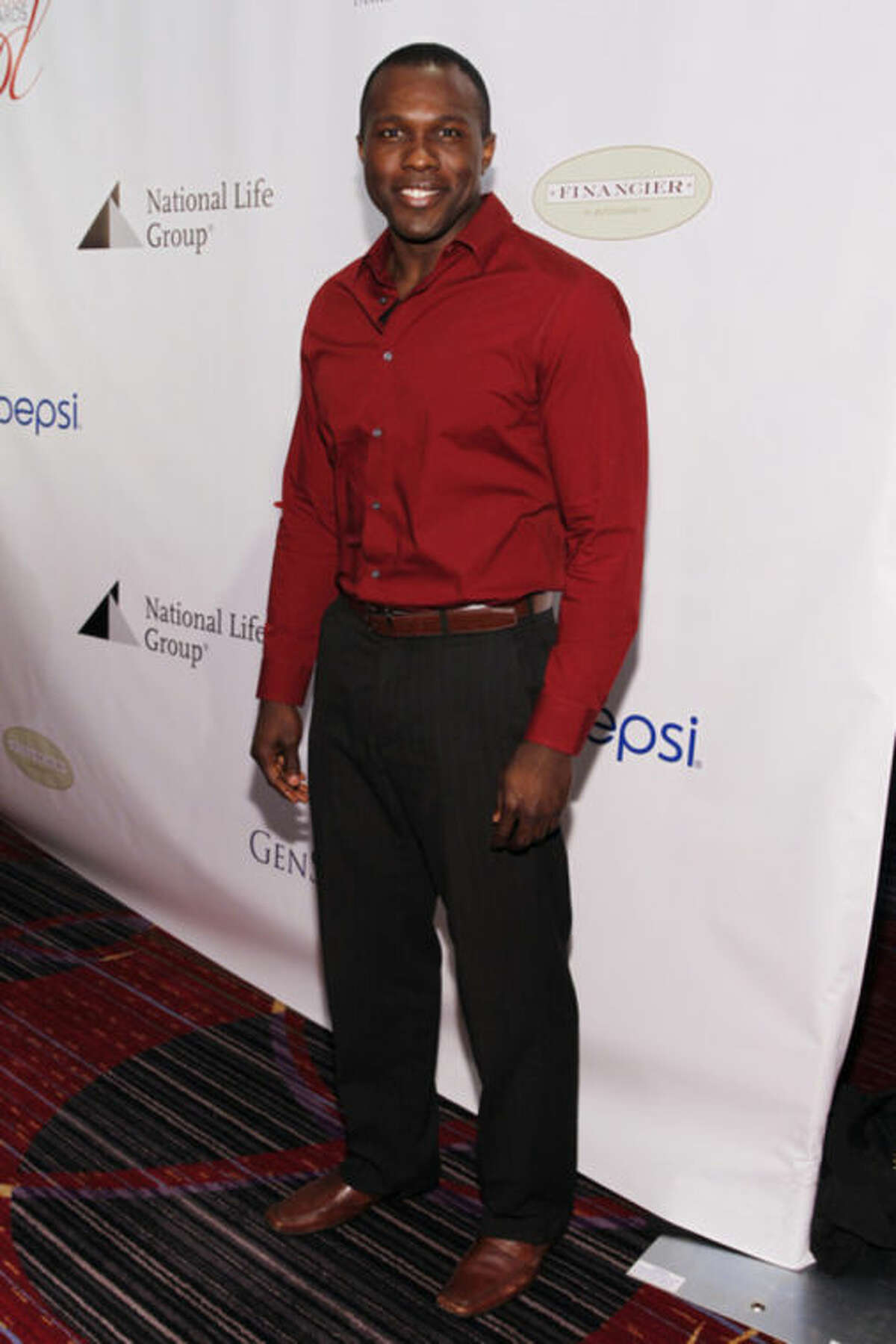 FILE--This Friday, May 16, 2014 file photo shows Joshua Henry at the 80th Annual Drama League Awards at Marriott Marquis Times Square, in New York. Henry, nominated for a 2014 Tony award for supporting actor and fellow cast members of the Tony Award-nominated musical
